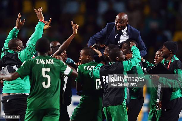 Nigeria players and team members carry head coach Emmanuel Amuneke after winning the FIFA U-17 World Cup Chile 2015 Final between Mali and Nigeria at...