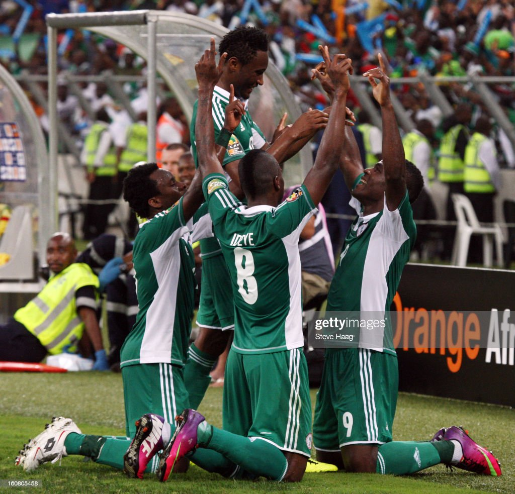 Nigeria players celebrate after the third goal during the 2013 African Cup of Nations Semi-Final match between Mali and Nigeria at Moses Mahbida Stadium on February 6, 2013 in Durban, South Africa.