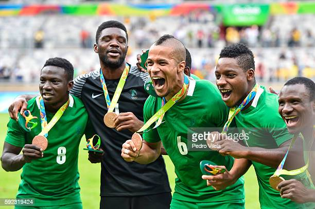 Nigeria players celebrate the bronze medal after the match between Nigeria and Honduras as part of Men`s Football Olympics at Mineirao Stadium on...
