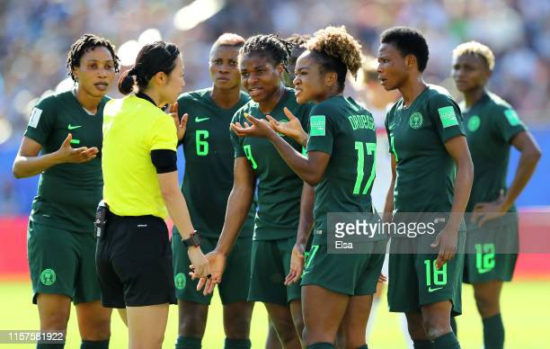 Nigeria players confront referee Yoshimi Yamashita after she awards Germany a penalty during the 2019 FIFA Women's World Cup France Round Of 16 match...