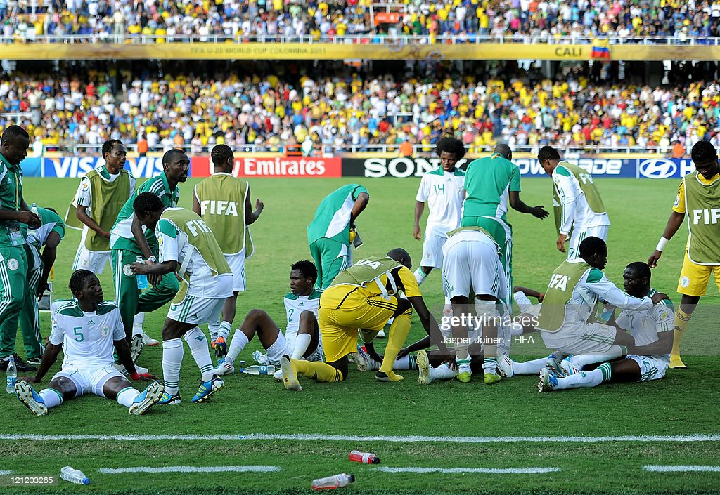 Nigeria players rest on the pitch prior to the start of extra timw during the FIFA U-20 World Cup Colombia 2011 quarter final match between France and Nigeria on August 14, 2011 in Cali, Colombia.