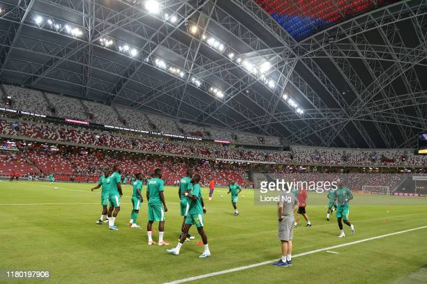 Nigeria players warm up before the international friendly match between Brazil and Senegal at the Singapore National Stadium on October 10, 2019 in...