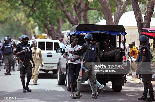Nigeria police detain suspicious people April 28 2011 near a polling station during a security operation to stave ballot boxsnatching in Bauchi the...