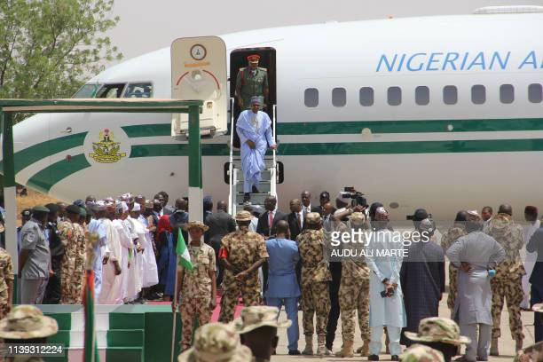 Nigeria President Muhammadu Buhari arrives at the Air Force base in Maiduguri on April 25 2019 Buhari will leave for Britain on April 25 on a private...