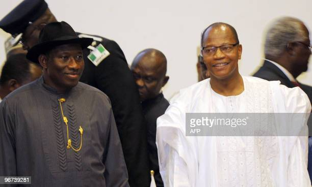 Nigerian Acting President Goodluck Jonathan and President of the Economic Community of West African States Commission Mohamed Ibn Chambas stand for...
