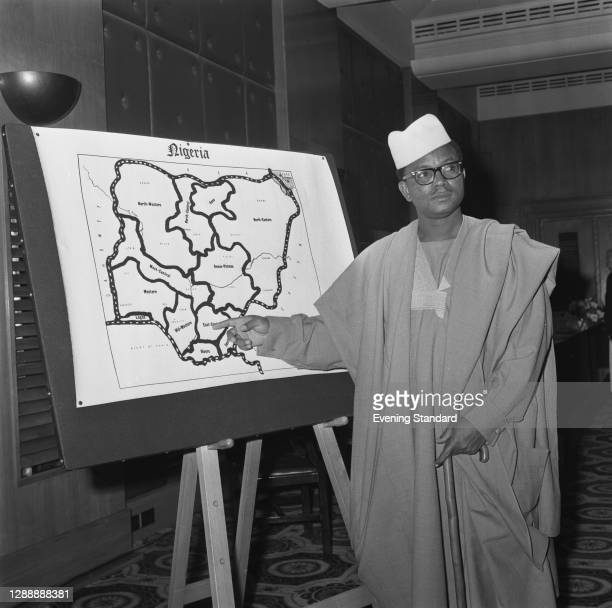 Nigerian activist Chief Anthony Enahoro points to a map of Nigeria during a press conference in London, UK, 18th July 1967. He is an advocate of...