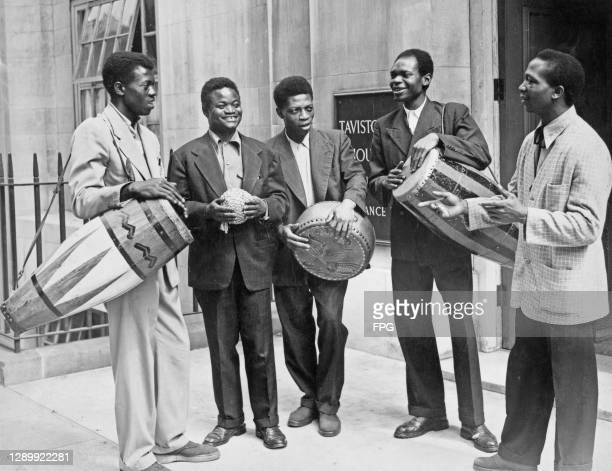 Nigerian actor and musician Billy Olu Sholanke with a group of unspecified Nigerian drummers at the BBC where they will be giving a demonstration of...