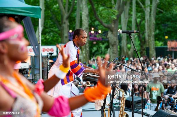 Nigerian Afrobeat musician Femi Kuti plays keyboards as he performs with his band Positive Force at Central Park SummerStage New York New York June...