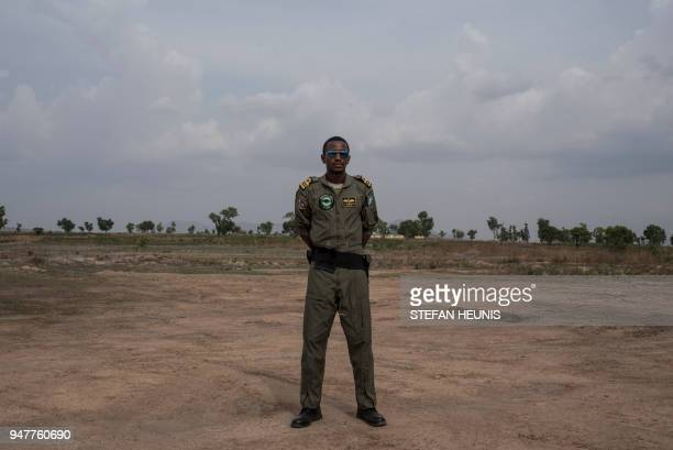 A Nigerian Airforce helicopter pilot poses for a photo at the African Land Forces Summit military demonstration held at General Ao Azazi barracks in...