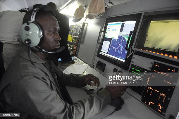 A Nigerian Airforce pilots sit to monitor vessels from ATR 42500 Maritime Patrol Aircraft acquired to fight maritime crime in collaboration with the...