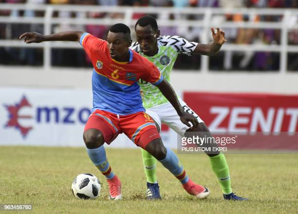 Nigerian and DR Congo players vie for the ball during an international friendly football match between Nigeria and DR Congo at the Adokiye Amiesimaka...