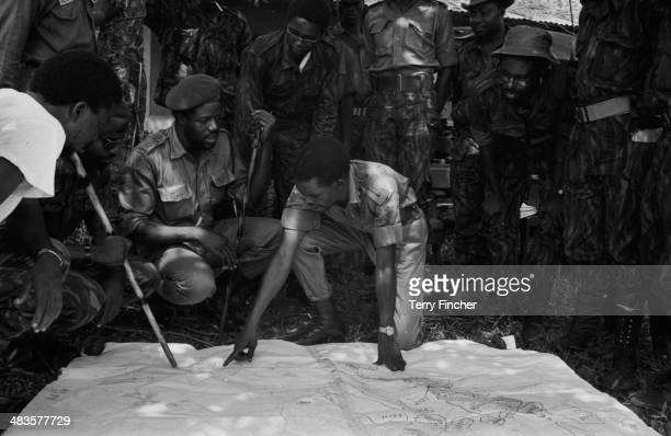 Nigerian Army Commander Benjamin Adekunle with his troops looking at a map of Port Harcourt during the conflict with Biafran forces 19th May Nigeria...