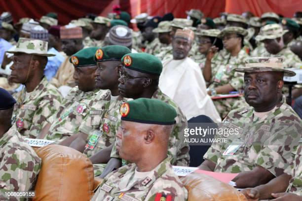Nigerian army officers listen to a speech of Nigerian president during the opening ceremony of the military staff annual conference on November 28 as...