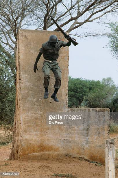 A Nigerian army soldier trains on an assault course