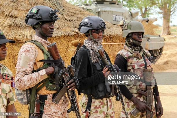 Nigerian Army soldiers stand at a base in Baga on August 2 2019 Intense fighting between a regional force and the Islamic State group in West Africa...