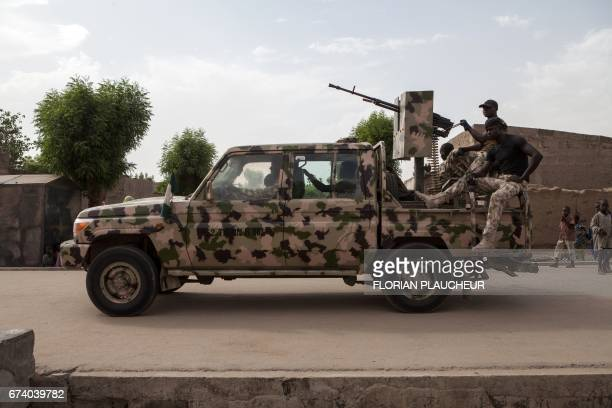 A Nigerian army vehicle patrols in the town of Banki in northeastern Nigeria on April 26 2017 Banki has been totally destroyed during battles between...