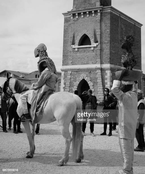 Nigerian artist Jelili Atiku takes part in a performance at Arsenale during the Press Opening of the Arte Biennale 2017 on May 12 2017 in Venice...