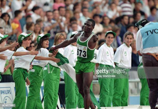 Nigerian athlete Ajibola Adeoye is congratulated after winnning the 100 metres event for singlearm amputees at the Summer Paralympics in Barcelona...