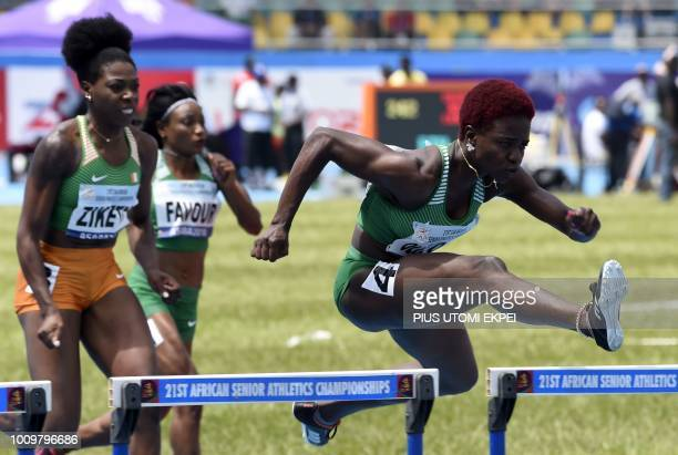 Nigerian athlete Oluwatobiloba Amusan competes in the women's 100metre hurdles event during The 21st African Athletics Championships at The Stephen...