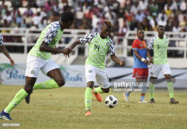Nigerian attacker Kelechi Iheanacho advances with the ball into DR Congo half during an international friendly football match between Nigeria and DR...