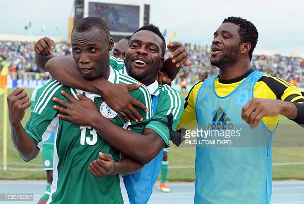 Nigerian attacker Mohammad Gambo is congratulated by his teammates after scoring a goal against Ivory Coast during the 2014 African Nations...