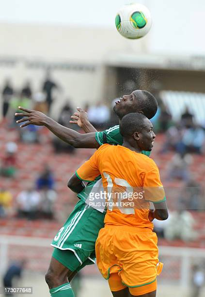 Nigerian attacker Mohammad Gambo vies for the ball with Ivorian defender Mathias Kassi during the 2014 African Nations Championship qualification...