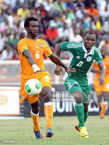 Nigerian attacker Mohammad Gambo vies for the ball with Ivorian defender Baresi Gloudoueu during their 2014 African Nations Championship...