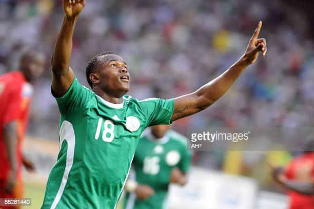 Nigerian attacker Obinna Nsofor celebrates after scoring a goal against the Kenya national team during the World Cup qualification match in Abuja on...