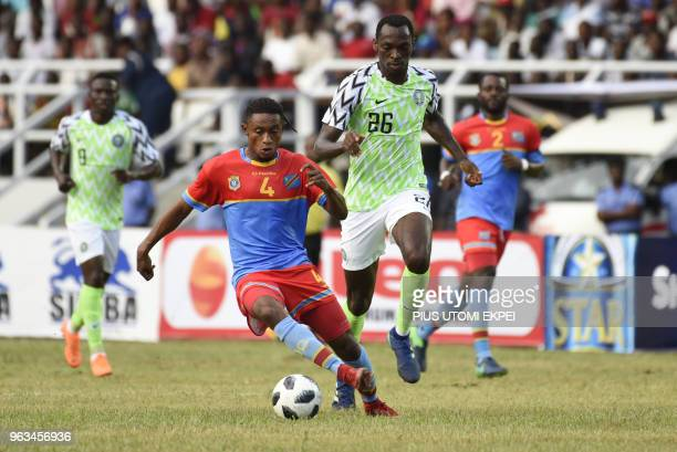 Nigerian attacker Simeon Nwankwo vies for the ball during an international friendly football match between Nigeria and DR Congo at the Adokiye...