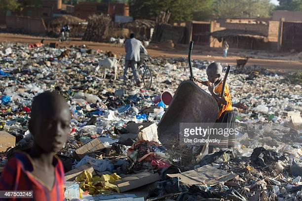 Nigerian boy collecting junk and garbage in a wheel barrow at a garbage dump on December 07 in Niamey Niger Photo by Ute Grabowsky/Photothek via...