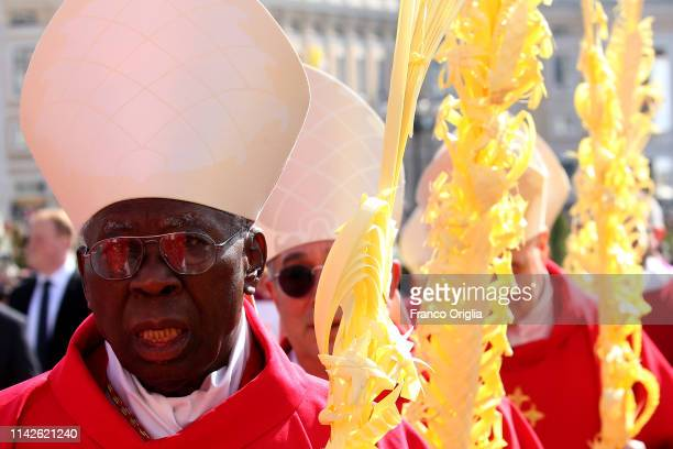 Nigerian Cardinal Francis Arinze attends Palm Sunday Mass celebrated by Pope Francis at St Peter's Square on April 14 2019 in Vatican City Vatican...