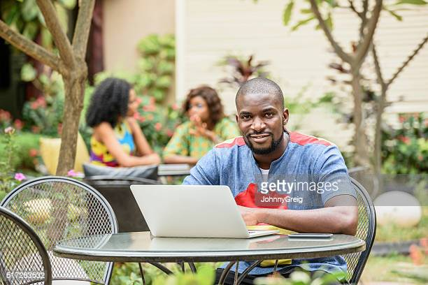 Nigerian casual businessman using laptop
