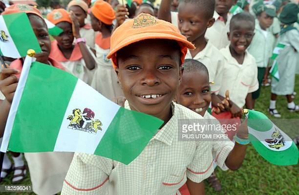 Nigerian children attend independence day celebrations in Lagos in October 1 2013 Nigeria's president Goodluck Jonathan said he had formed a panel...