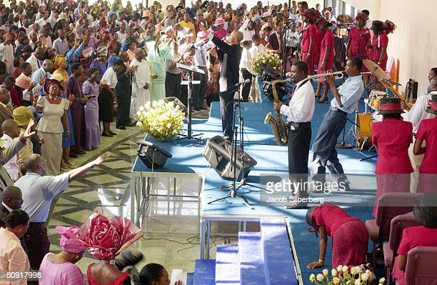 Nigerian Christians pray together at the City of David Church September 28 2003 in the affluent Victoria Island section of Lagos Nigeria Evangelical...