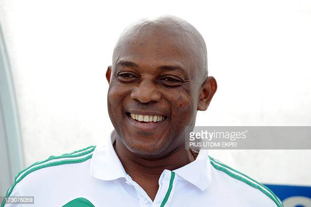 Nigerian Coach Stephen Keshi celebrates his team's goal scored by attacker Mohammad Gambo against Ivory Coast during the 2014 African Nations...