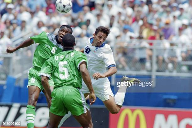 Nigerian defender Chidi Nwanu goes up for a header with Italian Roberto Baggio during second half action in the Round of 16 World Cup match at...