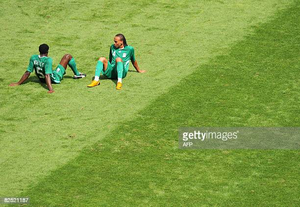 Nigerian defender Dele Adeleye and forward teammate Peter Odemwingie look dejected after Argentina won the men's Olympic football final over Nigeria...