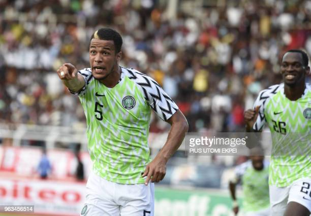 Nigerian defender William Ekong points to the crowd to celebrate his goal during an international friendly football match between Nigeria and DR...