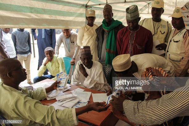 Nigerian electoral officials are seen at the INEC distribute observers cards on the eve of the country's national elections in Maiduguri in Borno...