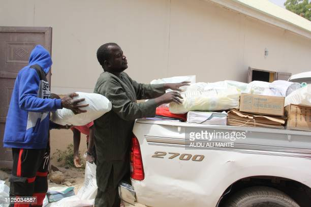 Nigerian electoral officials are seen at the INEC load electoral material to be dispatched on the eve of the country's national elections in...