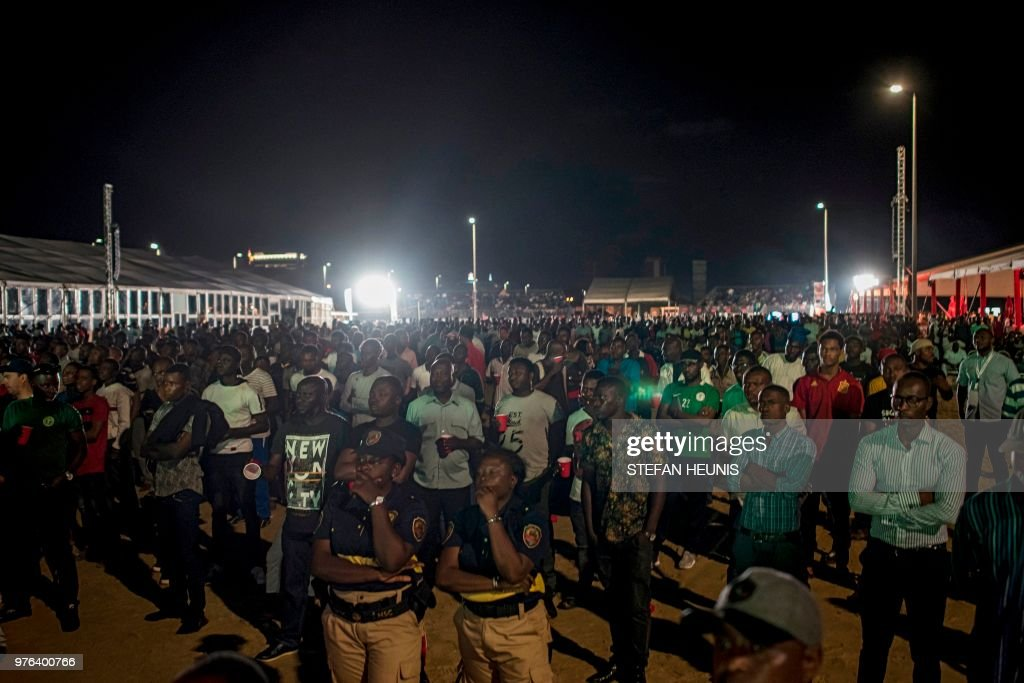 Nigerian fans watch the Russia 2018 World Cup Group D football match between Croatia and Nigeria at a fan zone in Lagos on June 16, 2018. - Croatia earned a comfortable 2-0 victory over a young Nigerian side in both sides' first group match at the World Cup in Kaliningrad on June 16.