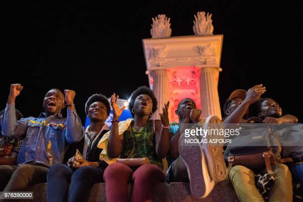 TOPSHOT Nigerian football fans react as they watch the Russia 2018 World Cup Group D football match between Croatia and Nigeria on a giant screen at...
