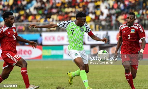Nigerian forward Ahmed Musa fights for the ball with Seychelles' players during the final football match of the Africa Cup of Nations qualifier...