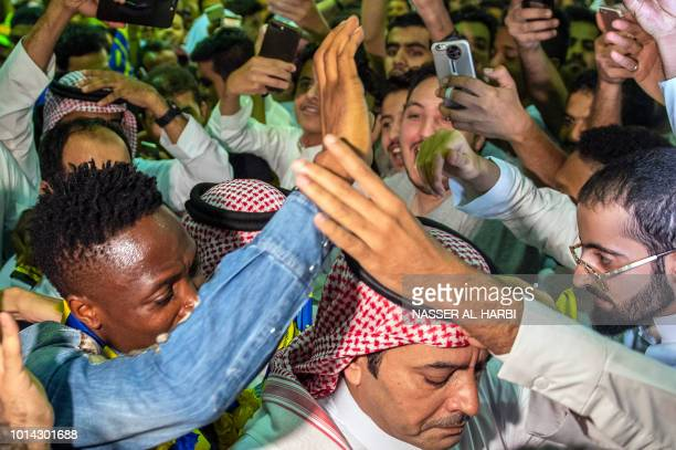 Nigerian forward Ahmed Musa is welcomed by AlNassr supporters upon his arrival at King Khalid International Airport in the Saudi capital Riyadh early...