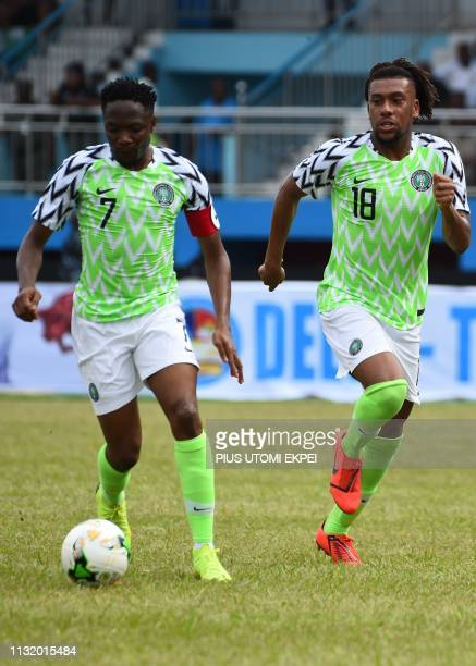 Nigerian forward Ahmed Musa runs next to Nigerian forward Alex Iwobi during the 2019 Africa Cup of Nations qualifier final match between Nigeria and...