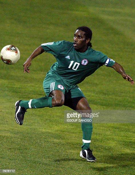Nigerian forward Jay Jay Okocha in action 04 February 2004 in Sfax, during their African Nations Cup match against Benin. AFP PHOTO ISSOUF SANOGO