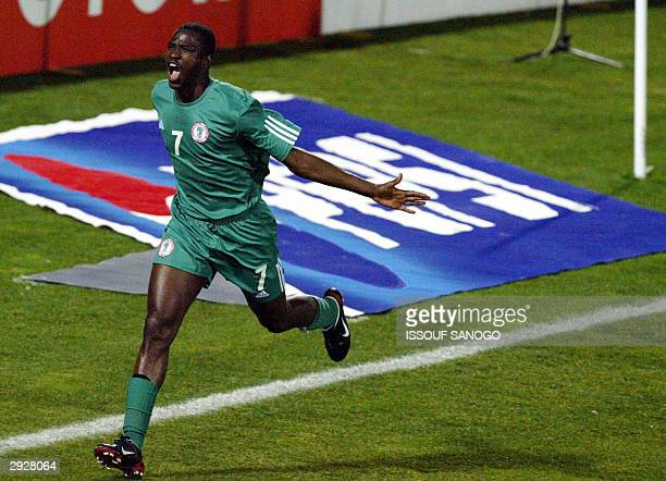 Nigerian forward John Utaka celebrates after scoring his team's second goal against Benin 04 February 2004 in Sfax, during their African Nations Cup...