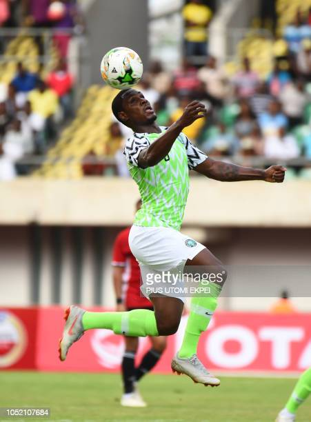 Nigerian forward Odion Ighalo heads to control the ball during the African Cup of Nations qualification match between Nigeria and Libya in Uyo Akwa...