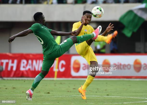 Nigerian forward Oghenekaro Etebo vies for the ball with South African midfielder Zwane Themba during the 2019 Africa Cup of Nations qualifier...