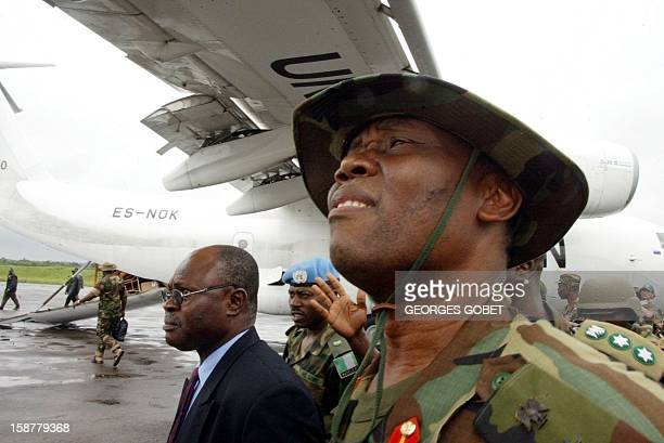 Nigerian General Festus Okonkwo commander of the first ECOMIL troops arrives 04 August 2003 at the RObertsfield International airport of Monrovia...